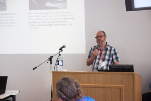 "David Clayton presenting his talk on: ""Exploring the uses of technology by and for older people to overcome loneliness and social isolation Social Care Interventions and Self-help Strategies"""